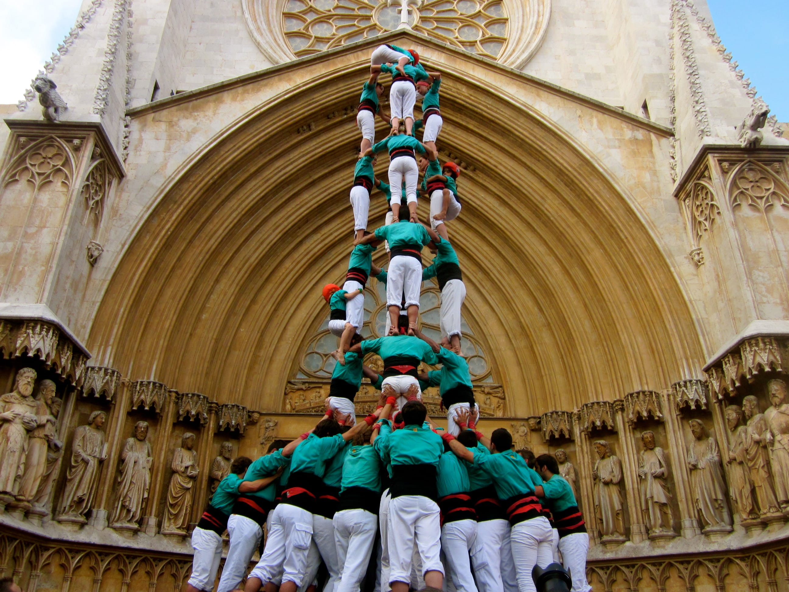 Catalan people climb on top of each other to build a high tower known as a castell