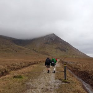 Two hikers follow a trail in Ireland