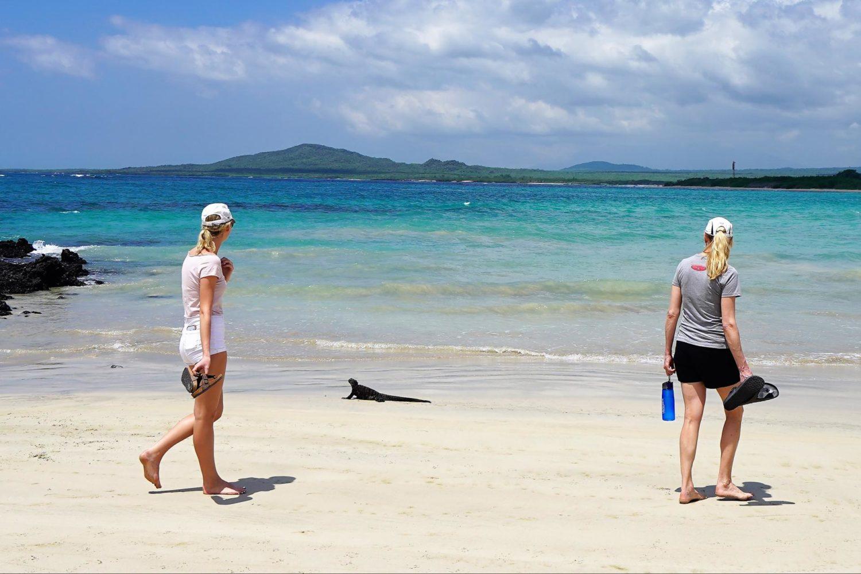 Hikers along a Galapagos beach