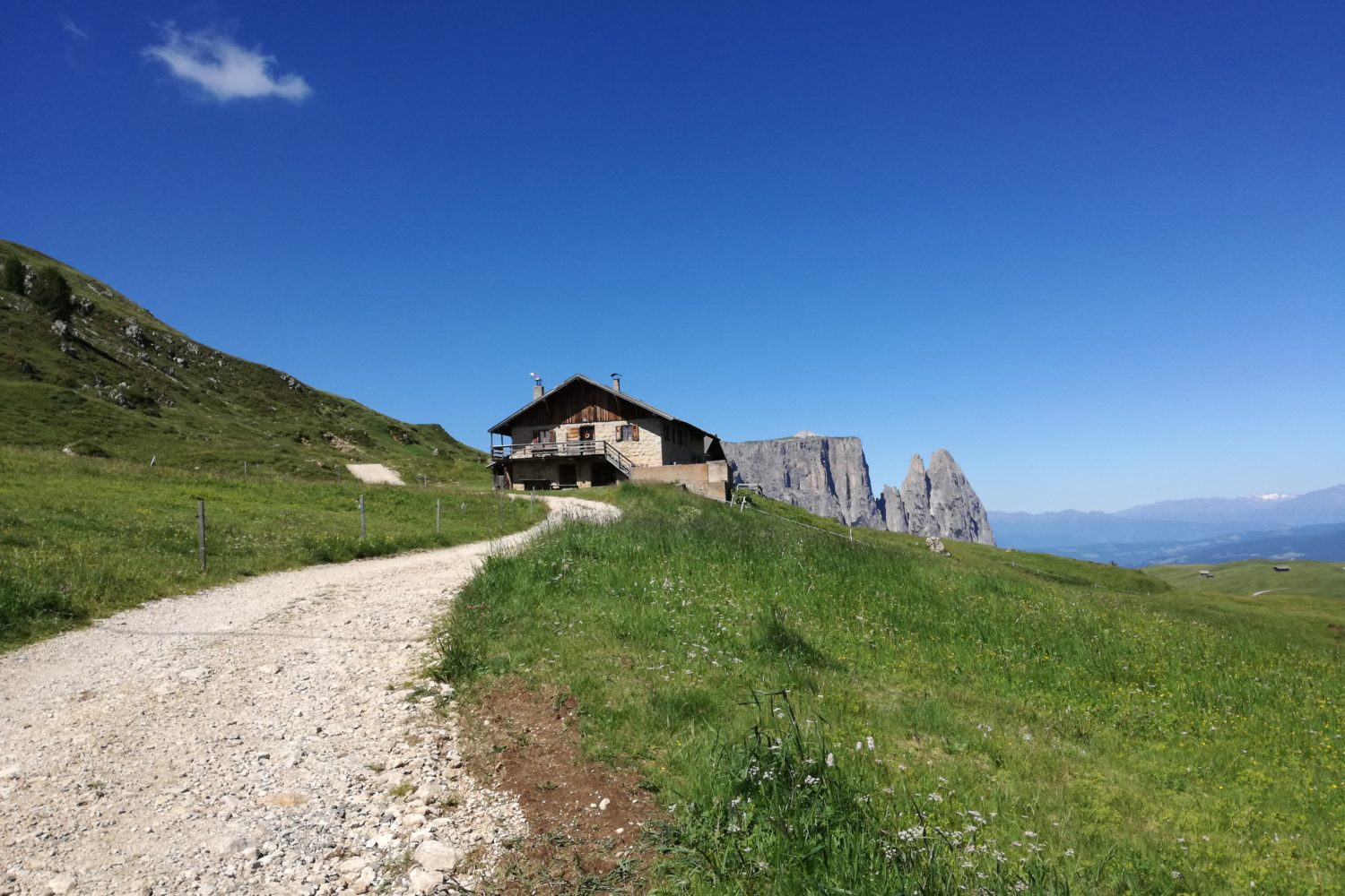Following a country path on the Dolomites self guided hiking tour