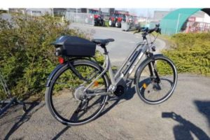 An e-bike with kickstand down in Normandy